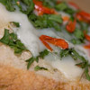 Bruschetta con rucola, caprino e peperoncino bishop crown